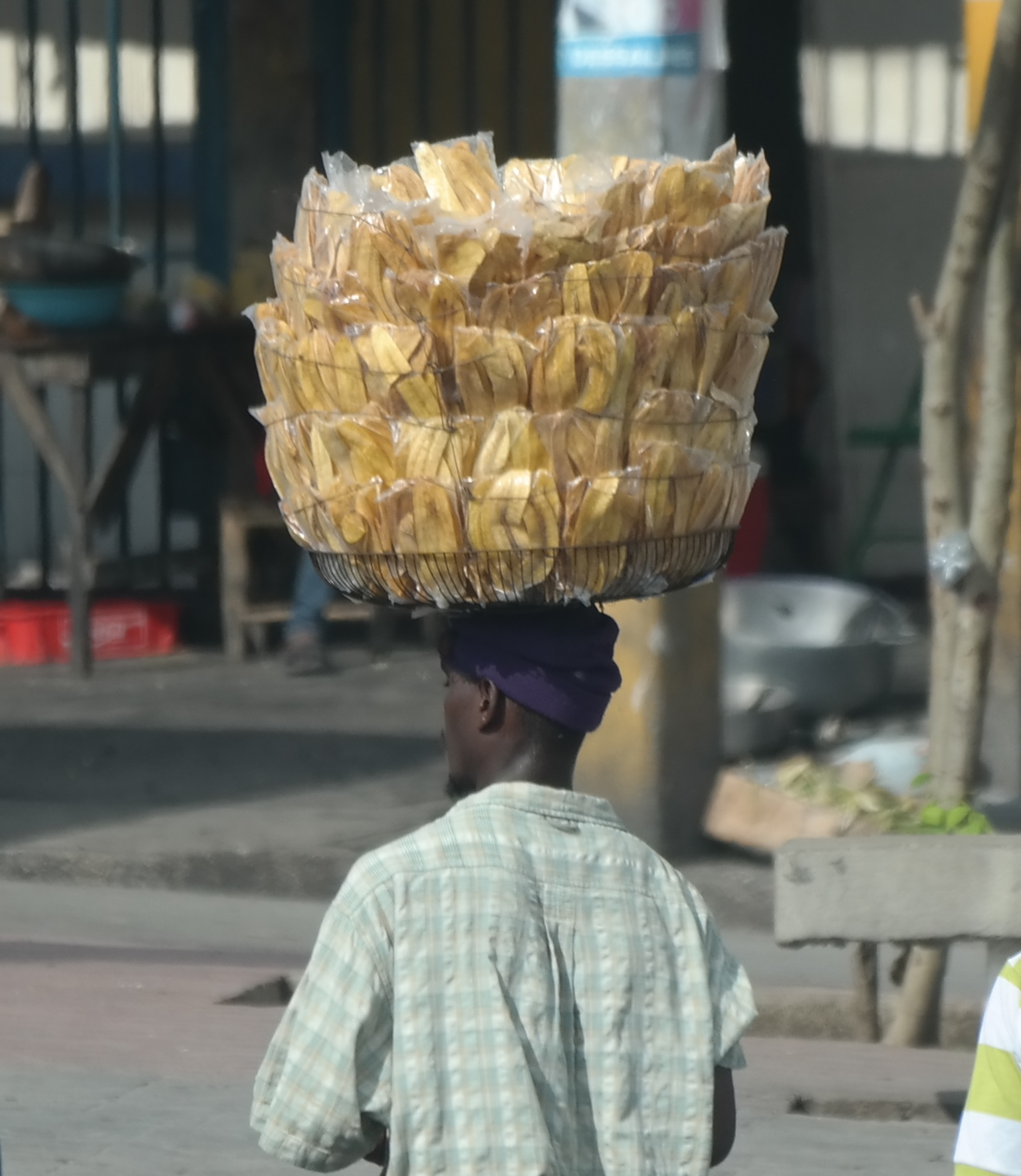 Packets of fried plantain snacks for sale
